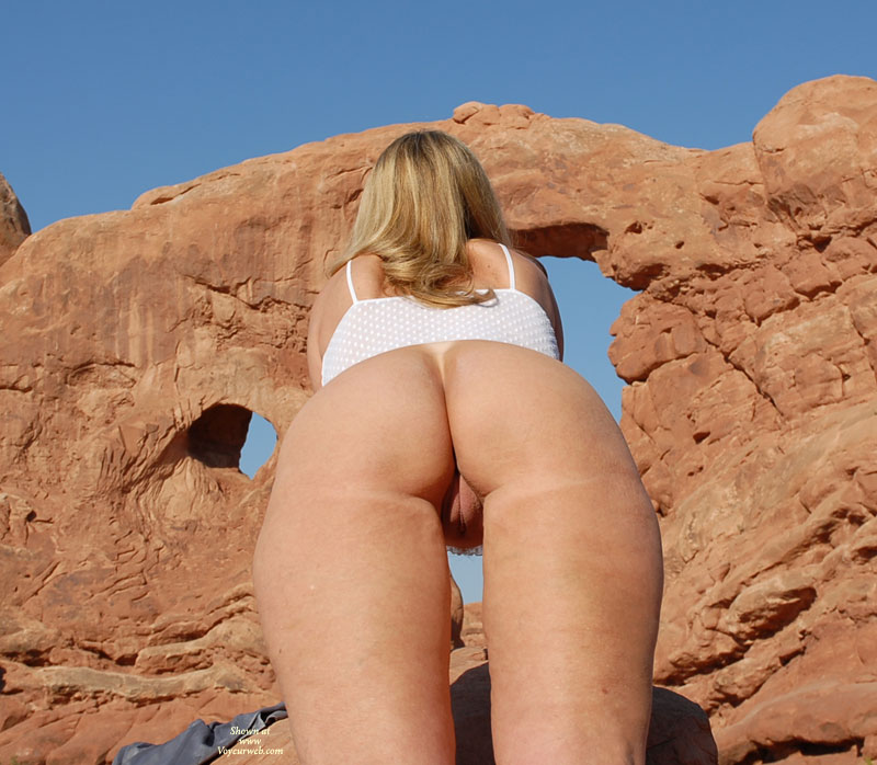 Pic #1 - Derrier Shot From Below - Blonde Hair, Round Ass, Shaved Pussy, Trimmed Pussy , Naked Outside, Twat Shot, Backside View, Outdoor Ass And Pussy, Great Outdoors, G-string Tanline, Labia Major Visible Thru Legs, Round Ass Shaved Pussy