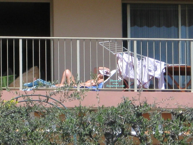 Pic #1 - Spring Is Here , Spring Is Here And So Is The Sun. This Means That My Neighbour Is Working On Her Tan.