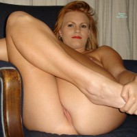 Milf's Pussy Peeks While Sitting With Legs Pulled Up - Blonde Hair, Milf, Shaved Pussy