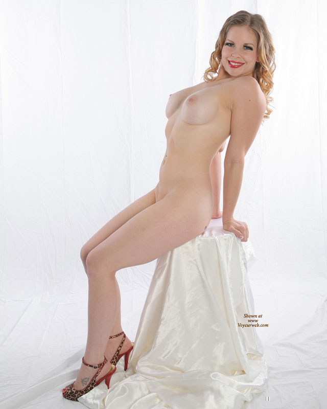 Pic #1 - Vintage Pose - Blonde Hair, Large Breasts, Long Hair , Leaning Back, Arched Back, Milky White Skin, Leopard Print & Red Opentoe Slingback Heels, Sitting With Arched Back, Studio Shot, Artistic On White