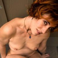 Nude Redhead Sitting Against Wall On Roof - Brown Eyes, Brown Hair, Milf, Perky Nipples, Red Hair, Naked Girl, Nude Amateur