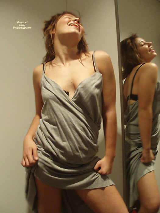 Pic #1 - Vibrant Energetic Girl , Sexy Pose, Standing Clothed Model Facing Camera, Hot Dress, Profile Reflected In Mirror On Side, Reflection In Mirrot, Black Bra, Fashion Model Vogue Pose, Head Thrown Back, Hitching Up Dress, Pulling Dress Up, Grey Dress, Sexy In Mirror, Hand Holding Dress Up To Top Of Thighs