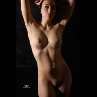 Frontal Nude Face And Torso - Dark Hair, Large Aerolas, Shaved Pussy, Naked Girl, Nude Amateur, Small Areolas , Playing With Lights, Figure Study, Shaved Muff, Artistic On Black, Belly Exposed, Medium Round Breasts, Arms Above Head, Large Erect Nipples, Thoughtful Gaze