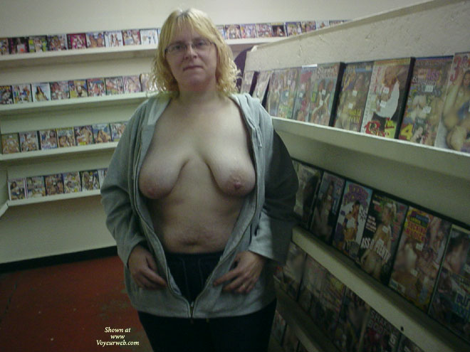 Pic #1 - Florida Mom Flashing In Adult Video Store , Florida Mom Started Out Flashing Guys In The Store Then Ended Up In The Video Booths In The Back Room Where One Of The Guys Came Up & Played With Her Tits. He Even Sucked On Her Nipples While I Watched Then I Joined Him. It Was The First Time She Had 2 Guys Sucking On Her Big Nipples At The Same Time. She Was Nervous So We Left Quickly But When We Got To The Car She Said She Was Very Wet & Horny After Having Both Of Her Tits Sucked On