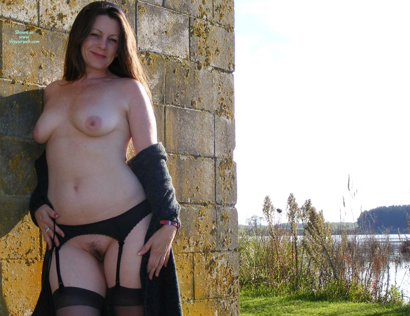 Dressed In Black Lingerie Outdoors - Brown Hair, Brunette Hair, Landing Strip, Long Hair, Stockings, Topless , Smiling At The Camera, Long Brown Hair Outside By Wall, Black Stockings And No Panties, Naked Brunette Leaning Against A Wall, Late Afternoon Sun On Naked Brunette By Lake, Naked Outside By A Lake, One Shoulder Leaned Against The Wall, Standing With Coat Down Showing Medium Sized Boobs, Hands On Thighs Topless, Landing Strip With Black Garterbelt And Stockings