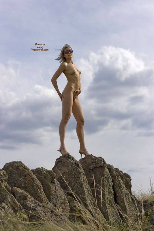 Pic #1 - Naked Girlfriend On High Heels Staning On A Rock - Blonde Hair, Heels, Long Hair, Sunglasses , Wind Blown Hair, Standing On Rocks, Shoulder-long Straigth Blond Hair, Landscape Lady, Clouds In Background, Flat Belly, Fit Body, Sun Glasses, Skinny Body, Heels And Sunglasses, A Little Risky For High Heels, Standing On Rocks Wearing High Heels
