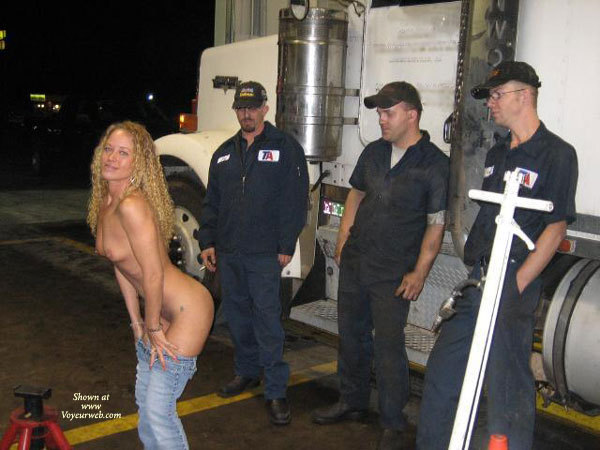 Pic #1 - Mooning Truck Drivers - Topless , Blue Denim Jeans, Showing Her Bum To An Audience, Jeans Half On, Smiling Topless Beauty, Leaning Forward With Jeans Down To Her Knees
