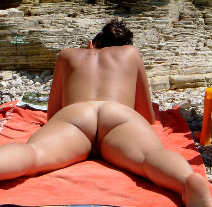Pic #1 - Girl Reading Naked On The Beach - Nude Beach, Round Ass, Beach Voyeur , Smooth Tanned Skin, Public Nudity, Tanned Ass, Smooth Thighs, Firm Tanned Back, Young Firm Body, Tanning On The Beach, Tanning On Beach Maked From Behind, Pebbles Beach
