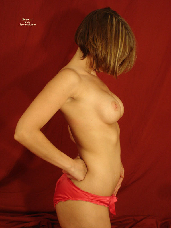 Pic #1 - Topless Wife Profile Shot - Topless, Naked Girl, Nude Amateur, Topless Wife , Chin Length Hair With Side View Of Breasts, Panties But No Top, Short Cropped Hair, Semi Nude In Red Panties, Right Profile, Fit Athletic Build, Hand On Hip, Red Satin Panties, Red Panties, Profile View Standing