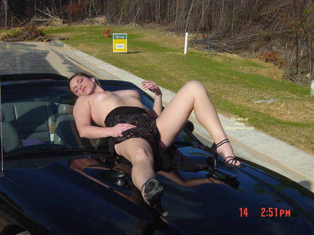 Pic #1 - Hood Ornament - Heels, Small Tits, Topless , Topless Leisure, Reclining On Car Hood, Posing Outdoors On The Car, Black Strappy High Heels, Black Dress, Lying On A Car, One Knee Up One Knee Down, Posing With Car Outdoors
