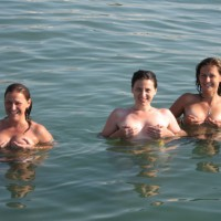 Three Ladies Up To Their Tits In Water And Hand Cups