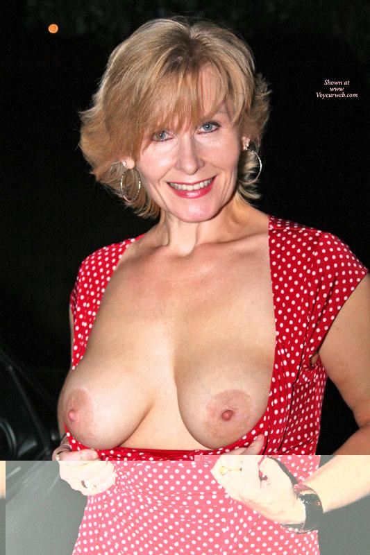 ... short blond hair, outdoors, red & white polka dot dress, mature women