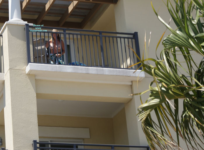 Pic #1 - Neighbor's Balcony , I Have Seen This Beauty Laying Out Naked On The Balcony Across The Street, But I Can Never Get A Good View From My Apartment.  On This Day I Lucked Out And Caught Her As She Was Heading Back In.  Amazing Body.