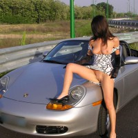 Girl Sitting On A Car Flashing - Brunette Hair, Flashing, Long Hair, Long Legs, Shaved Pussy, Spread Legs, Topless, Sexy Face