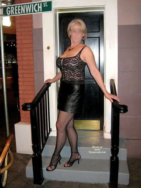 Here's JBunny in her see-through top and short leather skirt.