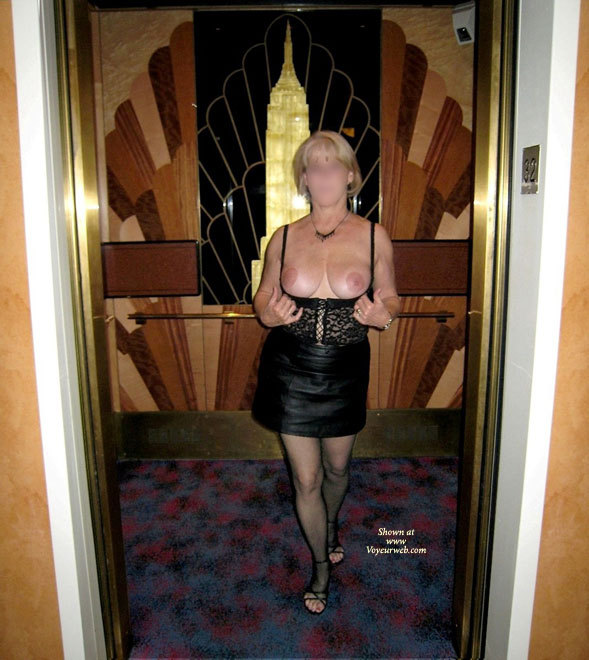JBunny was rather excited from our evenings activities as she excited the elevator and with very little prompting from me agreed to do a nude photo shoot in the elevator lobby.
