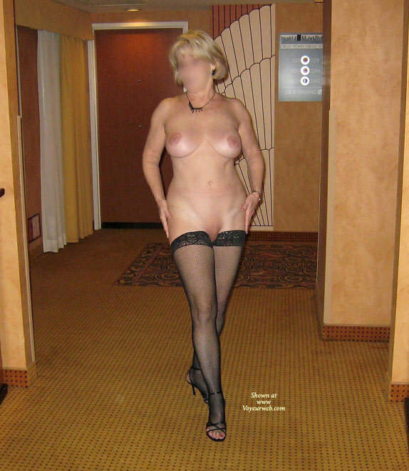 This is one of the many pictures we took in the elevator lobby. If your are interested in seeing more pictures from our elevator lobby photo session be sure to let JBunny know with a nice, or erotic, or humorous, or thoughtful comment. I don't think you will be disappointed. Cheers!
