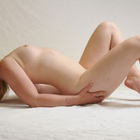 Kiwi: nude girl arched back on white
