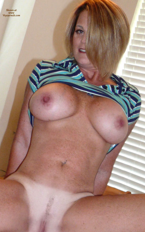 Sitting Nude By Window - Big Tits, Blonde Hair, Blue Eyes, Milf, Naked Girl, Nude Amateur , Belly Button Piercing, Seated Frontal Nude, Face And Torso, Freckles, Blue Striped Short Sleeve Shirt, Milf Shot, Tit And Pussy Shot, Freckled Body, Tanlines