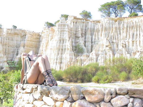 Pussy Flash - Sexy Legs , Outdoor Flash, Bare Pussy, Knees Bent, Legs Together, Sitting On Rock Ledge With Spires In Background, Black Flat Lace Up Sandals, Loose Fitting Dress, Strappy Heels, Laying On Rocks, Sitting Upskirt, Peeka Boo Mini Dress, Ass On Rock