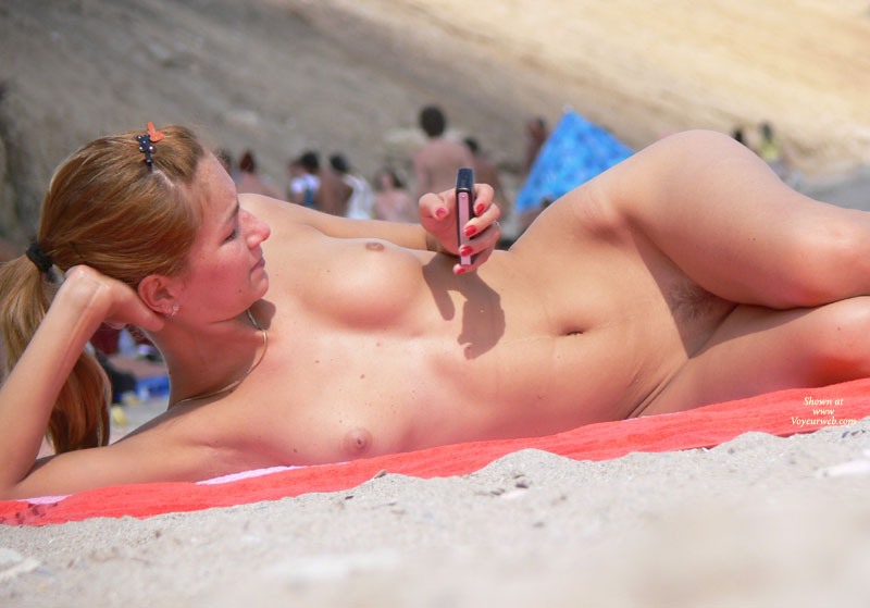 long straight brown hair, nude texting, nude lying at beach, beach voyeurism ...