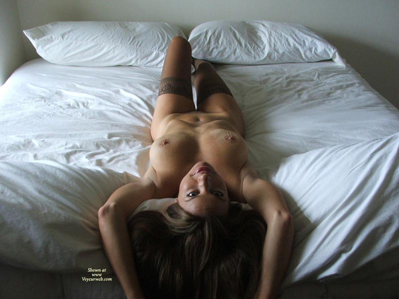 Pic #1 - Milf Landscape On White Sheets - Milf, Nude Amateur , Stout, Athletic Full-busted Beauty, Open Invintation, Lying On Back With Arms Up, Erect Nipples And Knobby Areolas, Top Down View Of Nude On Bed, Lying On A Bed, Nude With Stockings, Hair Down Over Foot Of Bed, Long Athletic Body Reclined From Above