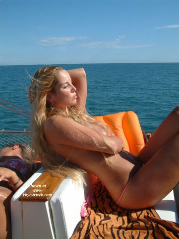 Pic #1 - Nude By Water - Long Hair , Nude By Water, Naked On A Boat, Blonde On A Boat, Pink Bikini Bottom, Long Blonde Hair, Bare Breast Hidden By Hair
