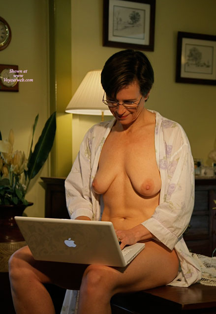 Pic #1 - Naked With Robe Open Indoors Online - Dark Hair, Milf , Milf Using Apple Laptop, Short Dark Hair With Glasses, Slightly Matured Breasts, Smiling With Robe Open, Surfing Internet Naked, Flower Pattern Robe, Short Dark Straight Hair, Big Areolas, Wearing A Pair Of Wire Rimmed Glasses Naked