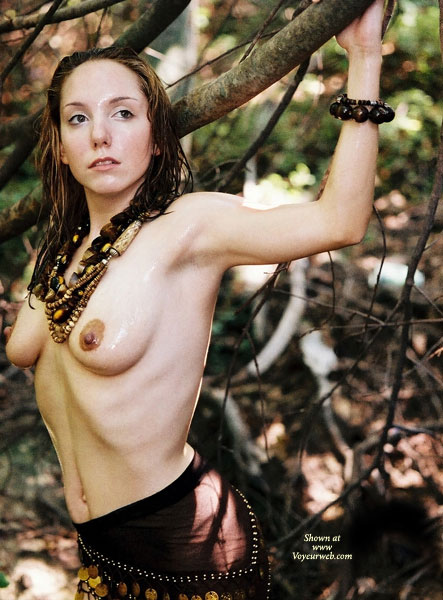 Pic #1 - Arms Up And Back Accentuating Her Slim Figure - Topless , Brown Beaded Sarong, Standing In The Woods, Arms Back, Perky Nipples, Beaded Necklace, Topless Amazon, Breasts And Belly Exposed, Topless Forest Pose, Beads And Breasts, Back Arched