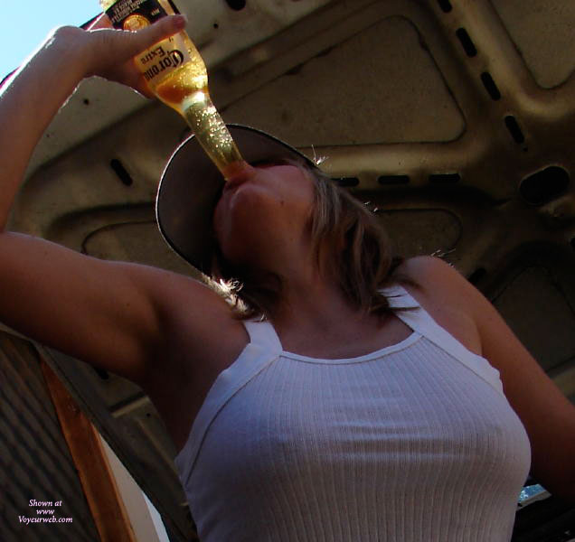 Pic #1 - Ribbed White Cotton Tank Top - Brown Hair, Long Hair , Braless Tank Top, Firm Breasts, Produce Placement, Nipple Tease, Sucking Bottle, See-through, Beer Drinking, Chugging Beer At The Beach