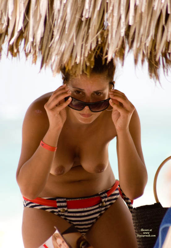 Pic #1 - Topless Leaning Over - Topless , Red Belted Bikini Bottom, Black And White Striped Bikini Briefs, Gravity Test, Girl At Beach, Suspicious Eyes, Sun Glasses, Hanging Tits, Brown Nipples, Bikini Bottoms, Hangers And Shades, Glasses And Tits