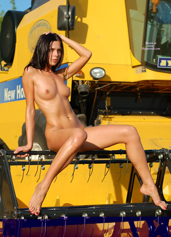 Nude Girl On Large Farm Equipment