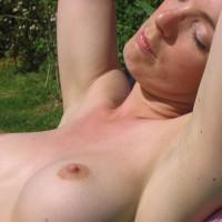 Suzy: topless sunbathing