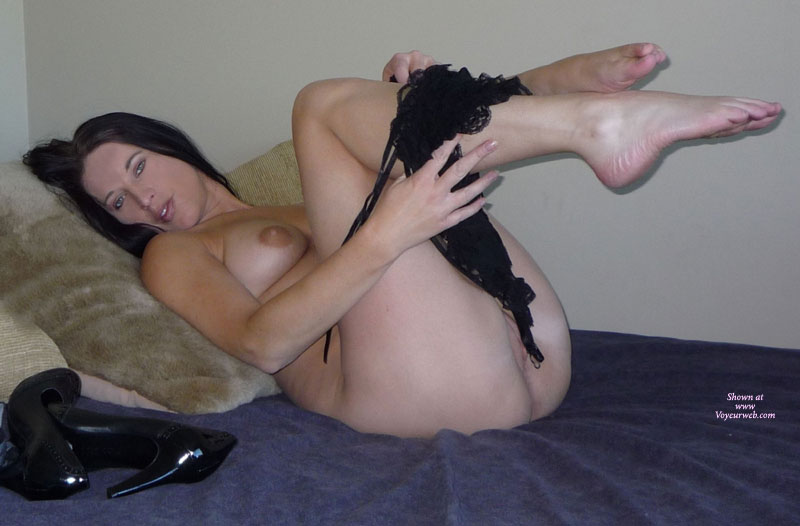 Pic #1 - Naked Brunette On Bed Removing Black Teddy - Blue Eyes, Brunette Hair , Knees Up In The Air, Lying On A Bed Naked, Removing Black Teddy, Legs In The Air Taking Off Teddy, Taking Off Panties, Legs And Feet, Black Heels Lying On Bed, Beautiful Blue Eyes, Pussy And Breasts Showing