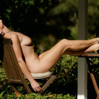 vanessab: sitting naked on patio furniture