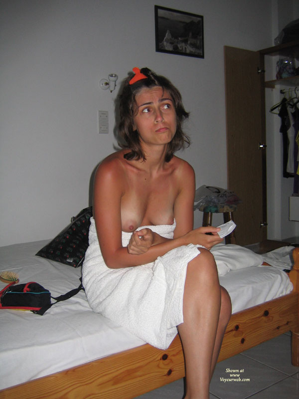 Pic #1 - Sitting On Bed With Towel Boobs Exposed - Brunette Hair, Topless , Sitting On Bed Topless, Worried Brunette In Towel After Shower, Sitting On Bed Breasts Showing, Holding Condom, Amateur, Wrapped In Towell, Sitting On Bed