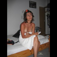 Sitting On Bed With Towel Boobs Exposed - Brunette Hair, Topless