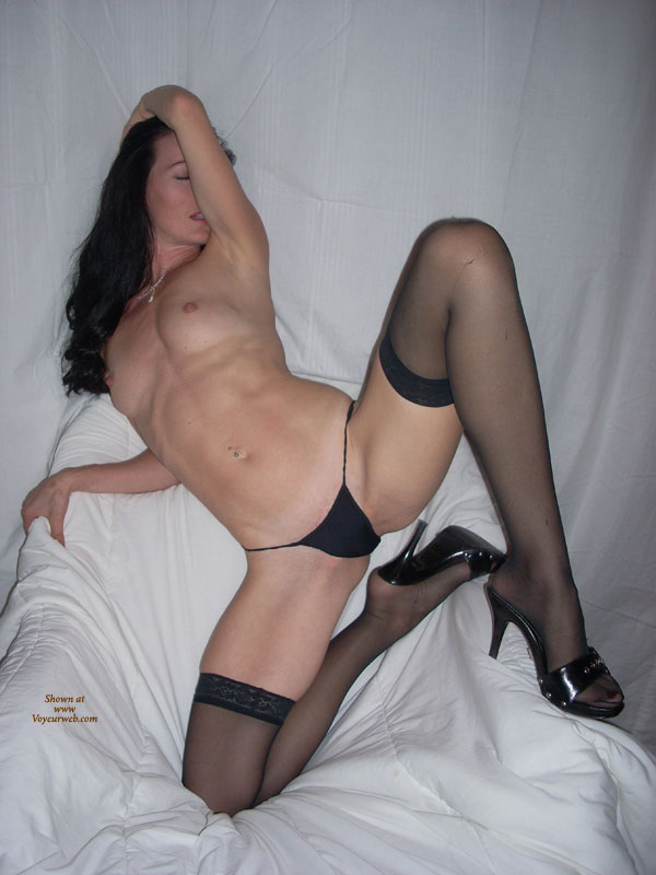 Dark Haired Vixen With Perky Nipples Lying Down With Black Hose And Shoes - Black Hair, Heels, Long Hair, Long Legs, Spread Legs, Stockings, Sexy Face , Leaning Back, Spreading Her Legs, Long Hair Over One Shoulder, Arm Over Face, Pierced Belly, Raised Arm Partially Covering Face, Black G-string, Black Panties, Black Lacetop Thigh-high Stockings, Leaning Back Onto A Chair, Legs Spread Wide And Bent Inward, One Arm Above Face, Sexy Shoes