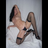 Dark Haired Vixen With Perky Nipples Lying Down With Black Hose And Shoes - Black Hair, Heels, Long Hair, Long Legs, Spread Legs, Stockings, Sexy Face