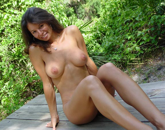 Pic #1 - Long Slim Legs , Long Slim Legs, Nude Outside, Long Brown Hair, Nude Sitting On Picnic Table Outdoors, Large Areola, Looking At Camera