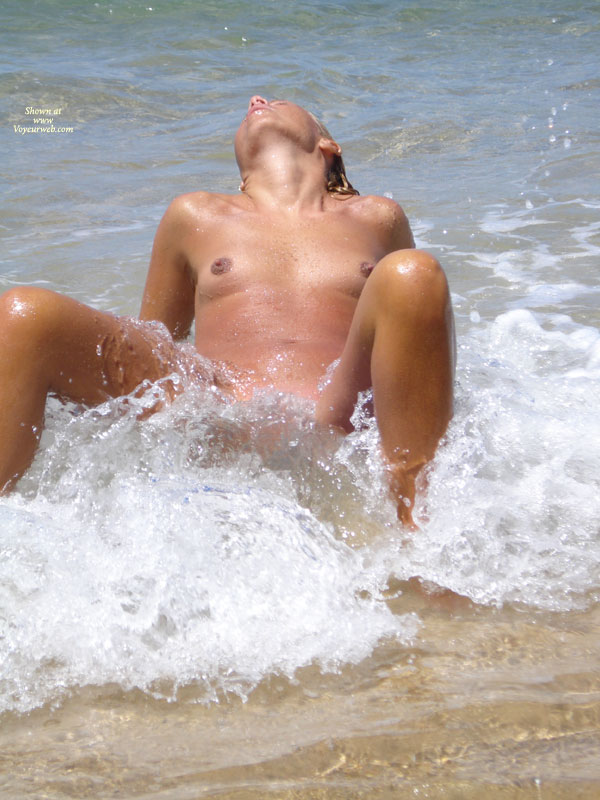Pic #1 - Girl Spreading Legs In Surf - Small Tits, Topless , Legs Bent And Open, Topless At Beach, Ocean Ecstasy, Waves Of Pleasure, Skinny Dipping, Shoreside Voyeur, Waves Lapping At The Vulva, In The Surf, Head Thrown Back, Sitting Back In Waves