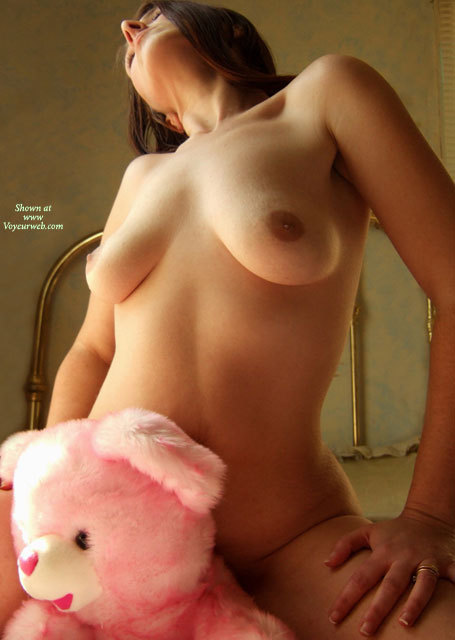 Pic #1 - Naked Girl Riding A Pink Bear - Natural Tits , Care Bear Getting Some Care, Hands On Thighs, Kneeling On Bed, Riding Teddy, Head Thrown Back, Showing Boobs By Bed, Soft Body