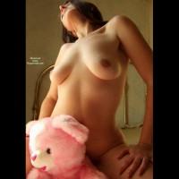 Naked Girl Riding A Pink Bear - Natural Tits