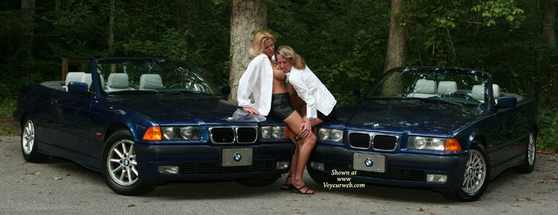 Pic #1 - Erotic Pose In Front Of Two BMW - Black Hair, Blonde Hair , Black Strappy Heels, Bmw Hot Posing, Lesbian Tit Lickers, White Shirts, Lesbo Tit Taster, Sexy Mature Women, Shiny Black Skirts, White Blouses, Black Mini, Slack Strap Sandals, Lesbian Licking