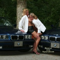 Erotic Pose In Front Of Two BMW - Black Hair, Blonde Hair