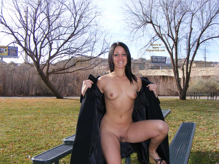 Pic #1 - Sitting On Picnic Table - Small Tits, Spread Legs, Trimmed Pussy , Legs Apart, Full Frontal Flash, Holding Coat Off Shoulders, Seated On Picnic Table, Naughty Smile, Naked Outdoors