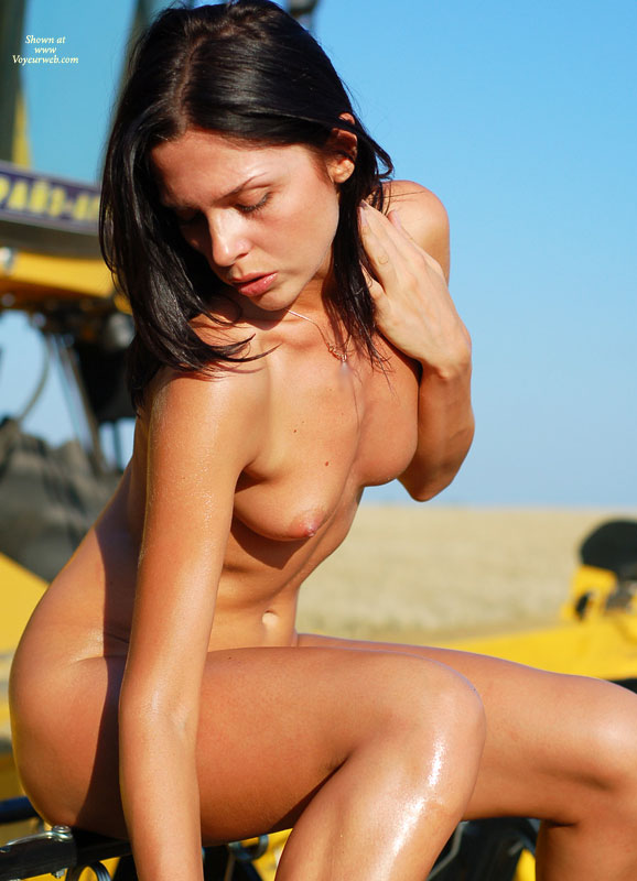 Pic #1 - Girl Sitting Nude On Construction Equipment - Black Hair, Small Breasts, Naked Girl, Nude Amateur , Bent Over, Looking Down Pose, Nude Profile Of A Girl, Wet Skin, Fully Nude, Seated, Side View
