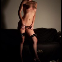 Headless Topless Girl Standing In Front Of A Couch - Navel Piercing, Stockings, Topless