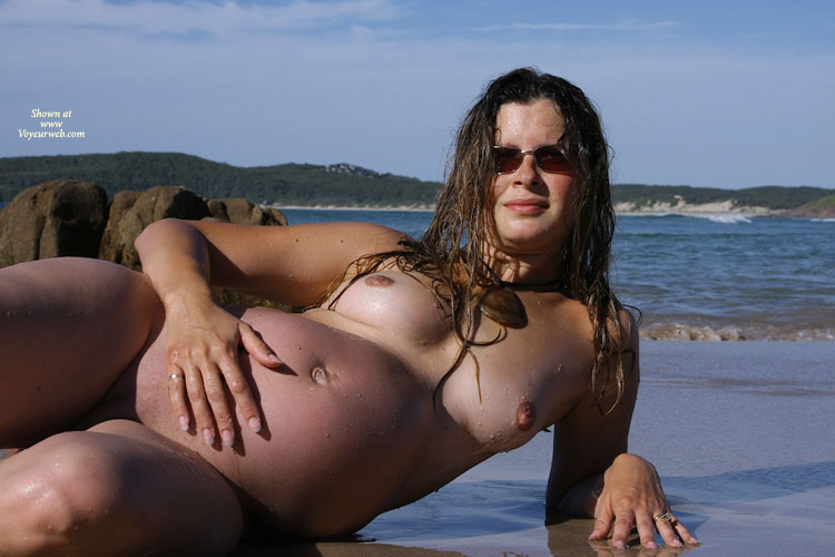 Pregnant Wet Hair Nude With Sunglasses At The Beach Leaning On Left Arm And ...