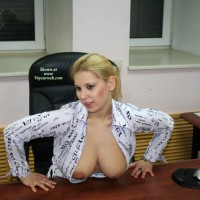 At The Office - Blonde Hair, Flashing, Large Aerolas , Flashing Sitting On Office Chair, Tits Out Of Shirt, White Printed Blouse, Big Tittties, Titty Flash, No-bra, Brown Aerolas